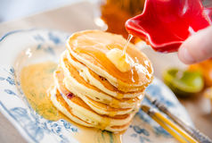 Delicious pancakes with butter and maple syrup. Closeup royalty free stock image