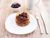 Delicious pancakes with cherry jam Royalty Free Stock Image