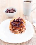 Delicious pancakes with cherry jam Royalty Free Stock Photos