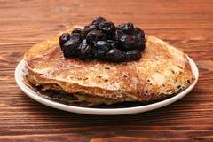 Delicious pancakes with cherry jam Royalty Free Stock Photo