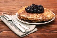 Delicious pancakes with cherry jam Stock Photo