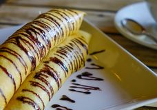 Delicious pancakes with chocolate sauce stock photo