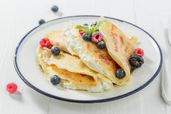 Delicious pancakes with cottage cheese and berries and powder sugar. Closeup of delicious pancakes with cottage cheese and berries and powder sugar Royalty Free Stock Photos