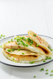 Delicious pancakes with cottage cheese and chive. Closeup of delicious pancakes with cottage cheese and chive Royalty Free Stock Photography