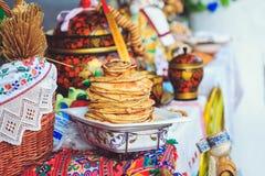 Delicious pancakes on the counter festival Maslenitsa stock photos