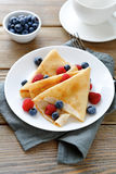 Delicious pancakes, crepes with raspberries and blueberries Stock Images