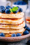 Delicious pancakes with fresh blueberries and honey Royalty Free Stock Image