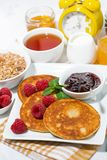 Delicious pancakes with fresh raspberries and jam for breakfast. Closeup Royalty Free Stock Image
