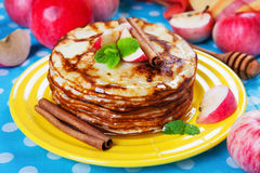 Delicious pancakes, honey, apples, cinnamon Stock Images