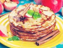 Delicious pancakes, honey apples and cinnamon. Vintage retro hip Royalty Free Stock Photos