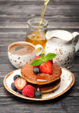 Delicious pancakes with honey and berries. Breakfast Royalty Free Stock Photos