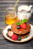 Delicious pancakes with honey and berries Royalty Free Stock Photos