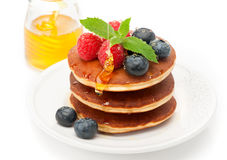 Delicious pancakes with honey and berries Royalty Free Stock Photography