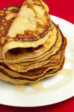 Delicious pancakes with honey sauce Stock Images