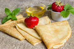 Delicious pancakes and honey. Royalty Free Stock Images