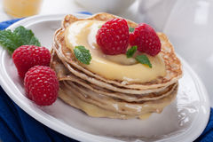 Delicious pancakes with lime curd and raspberries. Stock Image