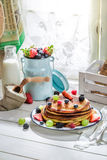 Delicious pancakes with maple syrup and fruits Stock Photo