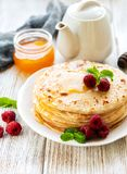 Delicious pancakes with raspberries stock images