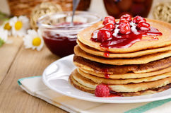 Delicious pancakes with raspberries on the wooden kitchen  table Royalty Free Stock Photography