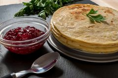 Delicious pancakes with raspberry jam stock image