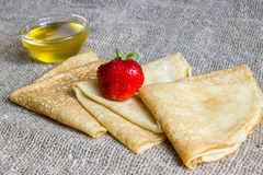 Delicious pancakes with strawberries and honey Stock Photos