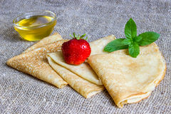 Delicious pancakes with strawberries and honey Stock Photo
