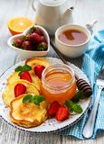 Delicious pancakes with strawberry stock images
