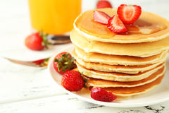Delicious pancakes with strawberry on white wooden background Stock Photo