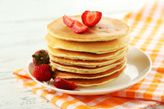 Delicious pancakes with strawberry on white wooden background Stock Image