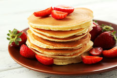 Delicious pancakes with strawberry on white wooden background Royalty Free Stock Photo