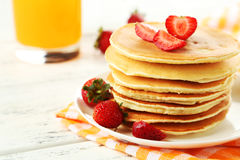 Delicious pancakes with strawberry on white wooden background Royalty Free Stock Photos