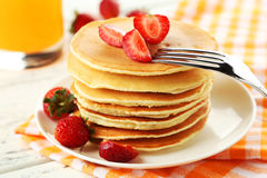 Delicious pancakes with strawberry on white wooden background Stock Photos