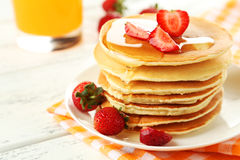 Delicious pancakes with strawberry on white wooden background Royalty Free Stock Photography