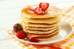 Delicious pancakes with strawberry on white wooden background Stock Images