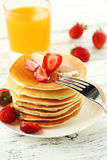 Delicious pancakes with strawberry on white wooden background Royalty Free Stock Images
