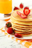Delicious pancakes with strawberry on white wooden background. Royalty Free Stock Photography
