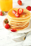 Delicious pancakes with strawberry on white wooden background. Stock Photography