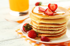 Delicious pancakes with strawberry on white wooden background. Stock Images