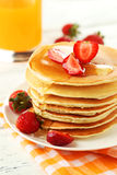 Delicious pancakes with strawberry on white wooden background. Stock Photos