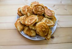 Pancakes in a plate on a wooden table stock photos