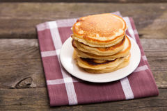 Delicious pancakes on a wooden table Royalty Free Stock Photos