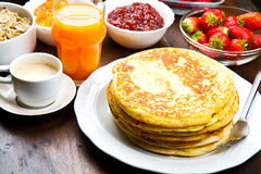 Delicious pancakes on wooden table with fruits. Some delicious pancakes on wooden table with fruits stock photo
