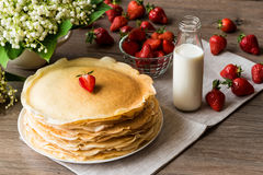 Delicious pancakes on wooden table with strawberries and milk Royalty Free Stock Photo