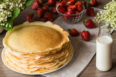 Delicious pancakes on wooden table with strawberries and milk Royalty Free Stock Photography
