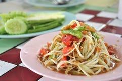 Delicious papaya salad. Authentic papaya salad with cucumber side dish Stock Photo