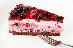 Delicious parfait cake with wildberries, cocoa tier and jelly icing Royalty Free Stock Photo