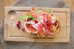 Delicious Parma Ham Sandwich On Wooden Plate Stock Photo