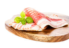 Delicious parma ham on silver fork isolated on wooden plate  wit Royalty Free Stock Images