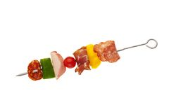 Delicious party food. Cured meat and vegetable snack Royalty Free Stock Image