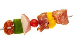 Delicious party food close up. Cured meat and vegetable snack Stock Images